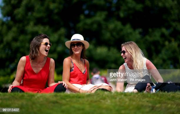 Tennis spectators Rosie Denee and Sarah Cole from London with Alice Harvey from Birmingham on day three of the Wimbledon Championships at the All...
