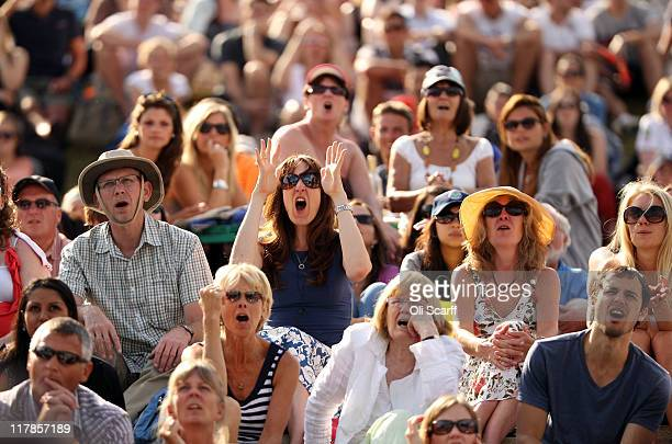 Tennis spectators watch Andy Murray's semi final match against Rafael Nadal of Spain on Day Eleven of the Wimbledon Lawn Tennis Championships at the...
