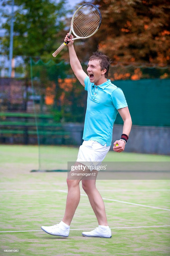 Tennis Sport Concept: Portrait of young Exclaiming Male Caucasian Tennis Player : Stock Photo
