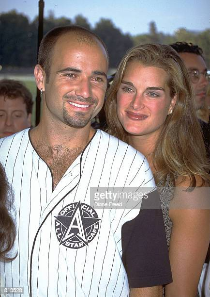 Tennis star Andre Agassi with wife actress Brooke Shields shown at the opening of the All Star Cafe in New York. Agassi said April 10 that his...