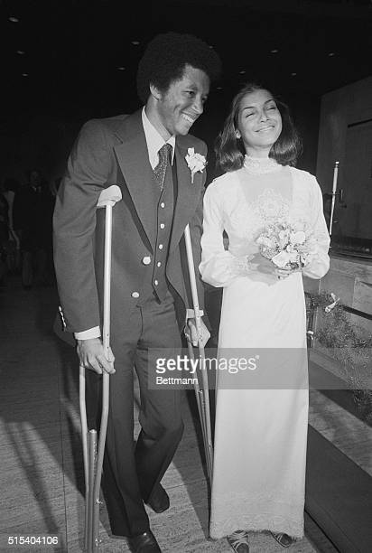 Tennis star Arthur Ashe with his bride Jeanne Marie Moutoussamy after their wedding 2/20 at the UN Chapel with US Ambassador Andrew Young officiating...