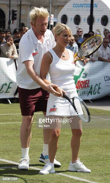 Tennis star Boris Becker giving a private tennis lesson to actress Zoe Lcker at the Ariel Celebrity Tennis Match held in Trafalgar Square on June 13...