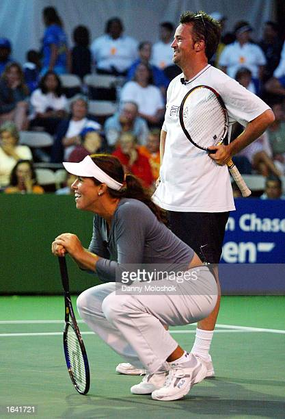 Tennis star Jennifer Capriati and actor Matthew Perry take a break during the JPMorgan Chase Open at the Manhattan Beach Country Club on August 4...