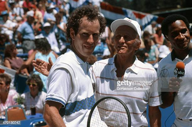 Tennis star John McEnroe and actor Kirk Douglas are interviewed by former NFL star Lynn Swann at an exhibition match for Cerebral Palsy Research at...