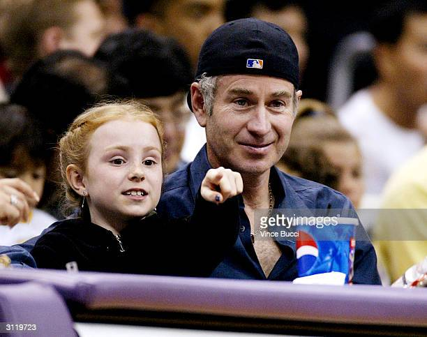 Tennis star John McEnroe and daughter Ava attend the game between the LA Lakers and the Milwalkee Bucks on March 21 2004 in Los Angeles California