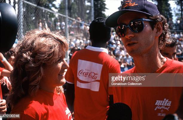 Tennis star John McEnroe is interviewed by former tennis star Tracy Austin at an exhibition softball game for Cerebral Palsy Research at the Mita...