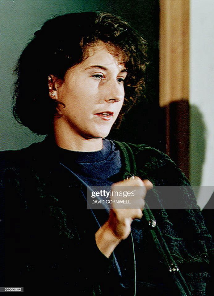 Tennis star Monica Seles makes a stabbing gesture 05 May 1993 while describing the knife attack against her during a tennis match in Germany 30 April. Seles, who is under the care of physician J. Richard Steadman, said she does not know how long she would be out of action.