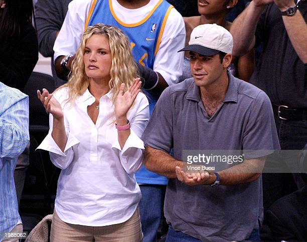 Tennis star Pete Sampras and wife actress Bridgette Wilson attend the Los Angeles Lakers v San Antonio Spurs playoff game on May 9 2003 at the...