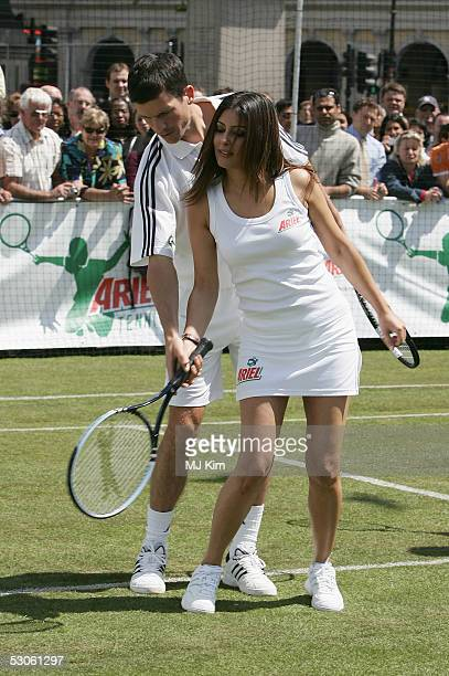 Tennis star Tim Henman giving a private tennis lesson to actress Laila Rouass at the Ariel Celebrity Tennis Match held in Trafalgar Square on June 13...