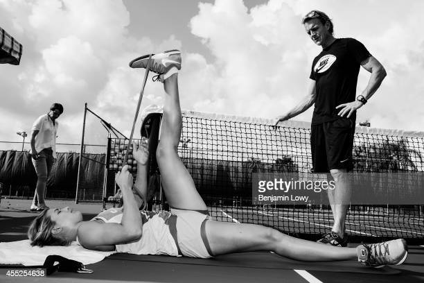 Tennis superstar Eugenie Bouchard works out and practices during her daily routine on a Fort Lauderdale tennis court on July 30 2014