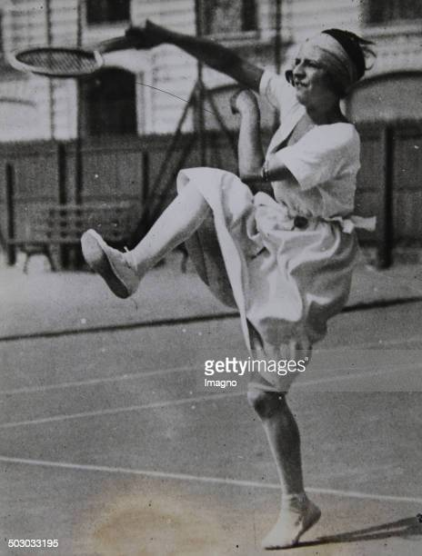 Tennis. The French tennis player Suzanne Lenglen in training for the game against Molla Mallory at Wimbledon. 1922. Photograph.