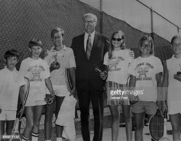 Tennis The Smiles of Victory John D Hershner President of the United Bank of Denver Congratulates Winners in the championship flight of the bank's...