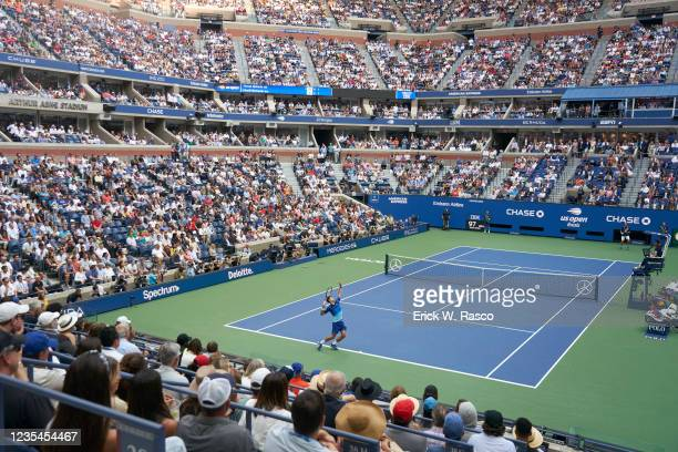 Aerial rear view of Serbia Novak Djokovic in action, serving vs Russia Daniil Medvedev during Men's Final at Arthur Ashe Stadium. Flushing, NY...