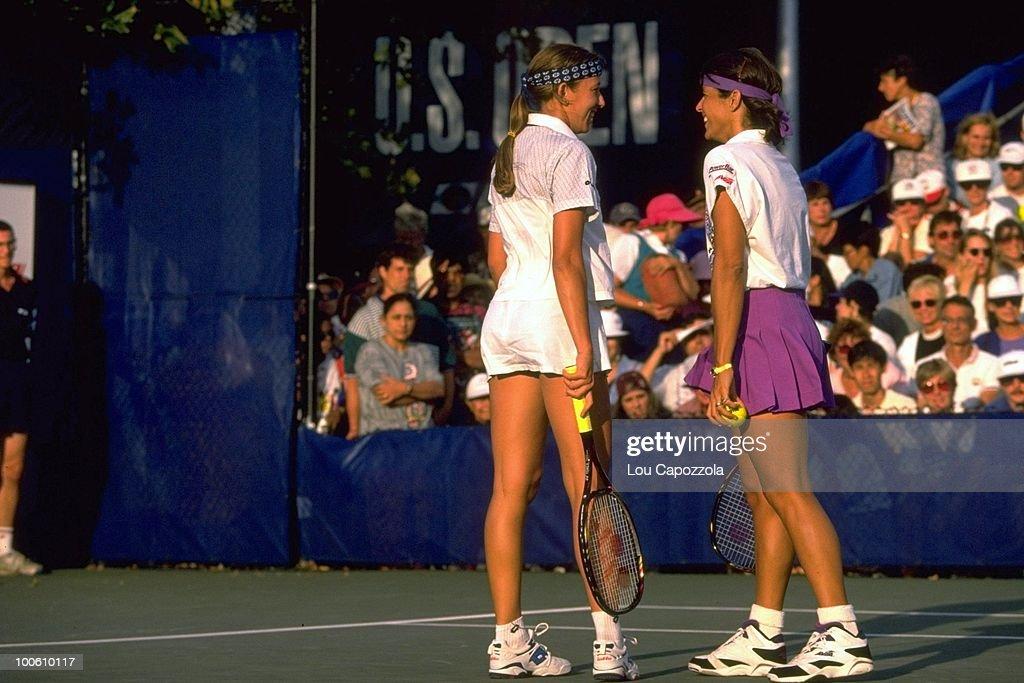 Belarus Natalia Zvereva and Puerto Rico Gigi Fernandez (pink skirt) during match at National Tennis Center. Flushing, NY 9/1/1994