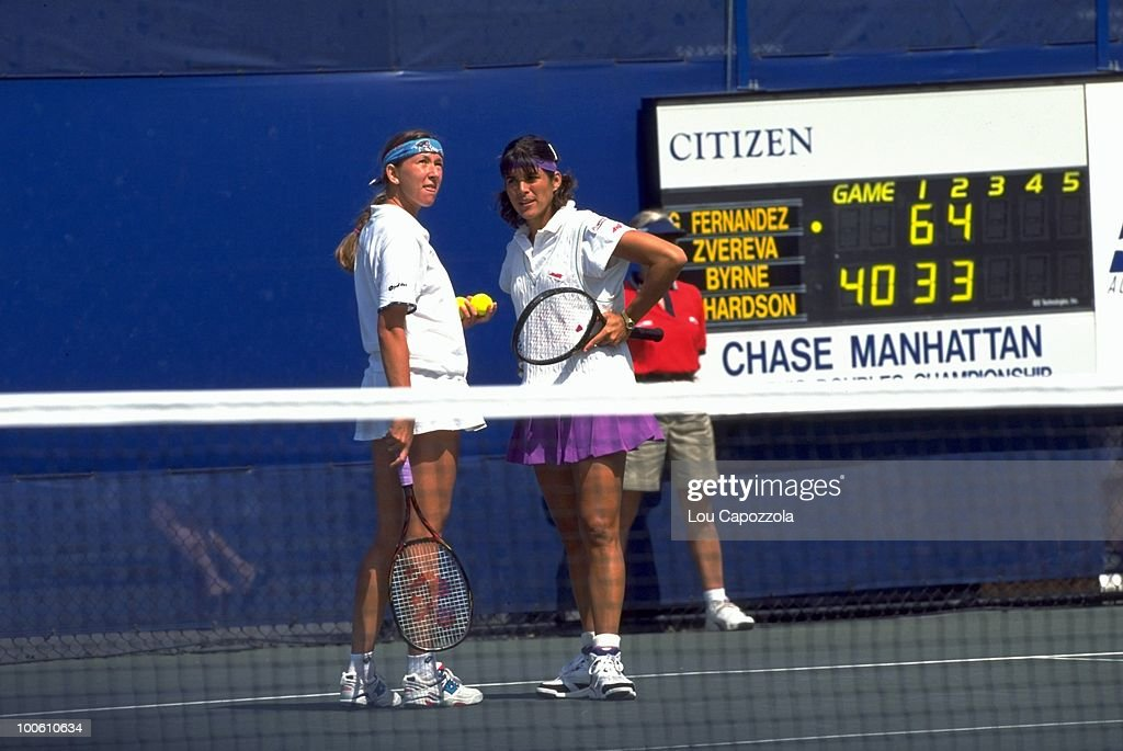 Belarus Natalia Zvereva and Puerto Rico Gigi Fernandez (pink skirt) during match at National Tennis Center. Flushing, NY 9/10/1994