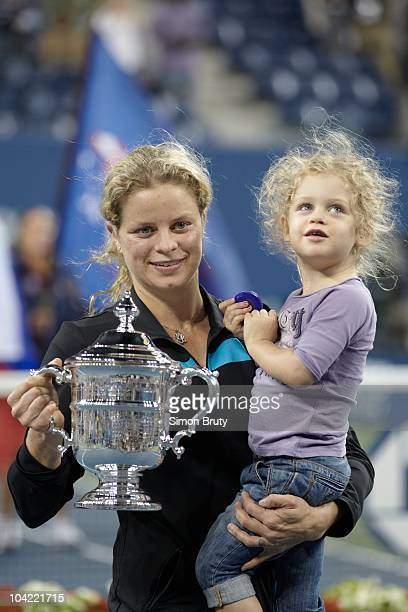 US Open Belgium Kim Clijsters victorious holding trophy with daughter Jada Ellie after winning Women's Final vs Russia Vera Zvonareva at BJK National...