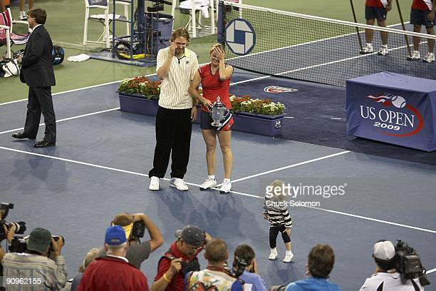 US Open Belgium Kim Clijsters victorious with daughter Jada husband Brian Lynch and winner's trophy after winning Women's Final vs Denmark Caroline...