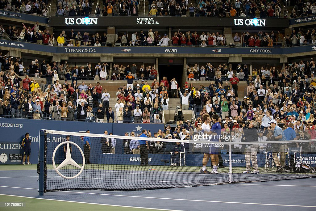 Great Britain Andy Murray victorious, greeting Serbia Novak Djokovic at net after winning Men's Final at BJK National Tennis Center. Erick W. Rasco F433 )