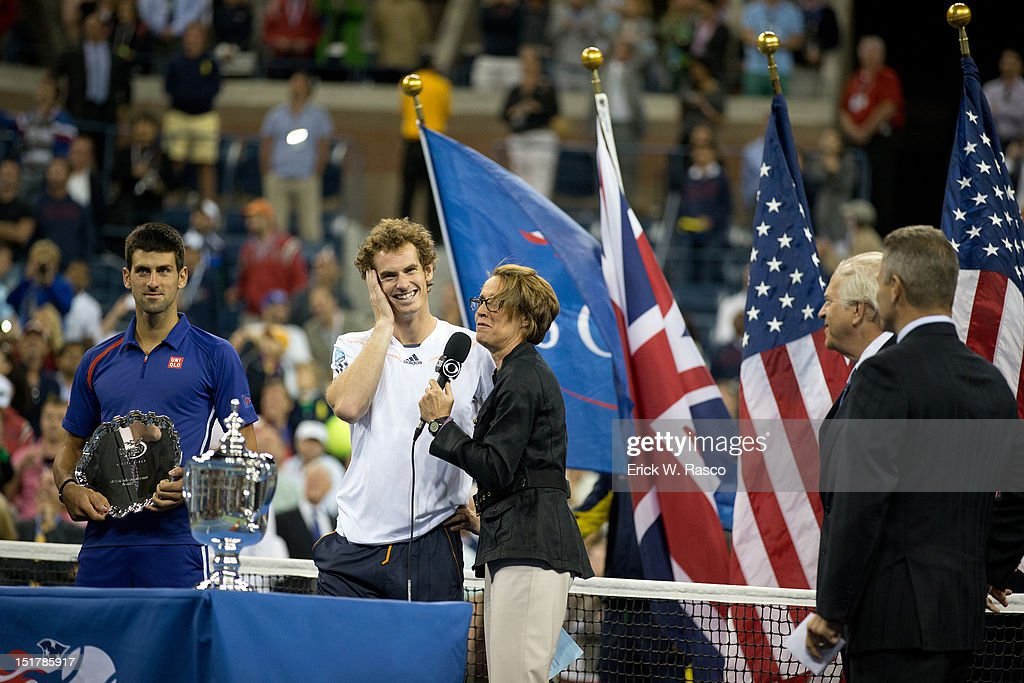 Great Britain Andy Murray victorious with CBS announcer Mary Carillo and US Open trophy after winning Men's Final vs Serbia Novak Djokovic at BJK National Tennis Center. View of Djokovic with runner up trophy. Erick W. Rasco F555 )