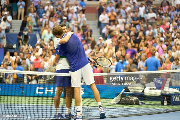 Rear view of Russia Daniil Medvedev victorious, hugging Serbia Novak Djokovic after Men's Final at Arthur Ashe Stadium. Flushing, NY 9/12/2021...