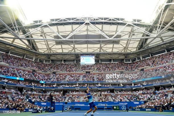 Rear view of Serbia Novak Djokovic in action, serving vs Russia Daniil Medvedev during Men's Final at Arthur Ashe Stadium. Flushing, NY 9/12/2021...