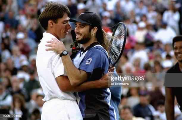 US Open USA Andre Agassi hugging Michael Stich after Men's Finals at USTA National Tennis Center Flushing NY CREDIT Al Tielemans