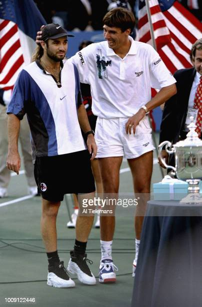US Open USA Andre Agassi with Michael Stich after Men's Finals at USTA National Tennis Center Flushing NY CREDIT Al Tielemans