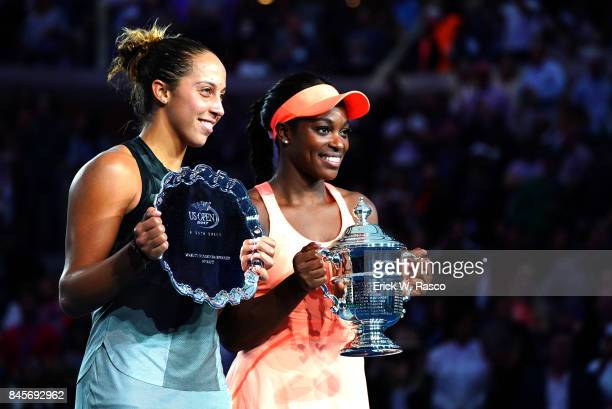 US Open USA Madison Keys with finalist trophy and Sloane Stephens victorious holding up US Open trophy after winning Women's Final match at BJK...
