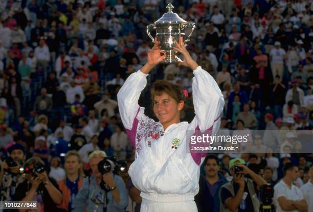 US Open USA Monica Seles victorious holding US Open Trophy above her head after winning Women's Finals at USTA National Tennis Center Flushing NY...