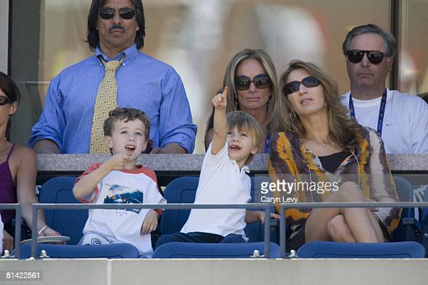 Tennis US Open View of wife Steffi Graf and son Jaden of USA Andre Agassi in stands during 4th round match vs Belgium Xavier Malisse at National...