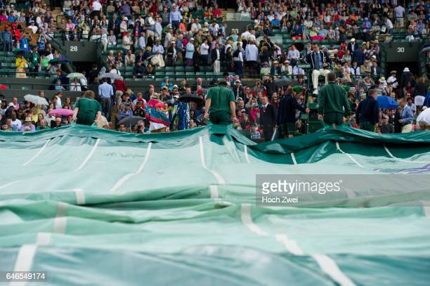 Wimbledon Championship 2014 Match was postponed due to rain on day seven of the Wimbledon Lawn Tennis Championships at the All England Lawn Tennis...
