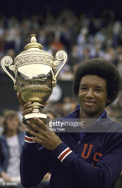 Tennis: Wimbledon, Closeup of American tennis player Arthur Ashe, victorious with trophy after winning tournament at All England Club, London, GBR...