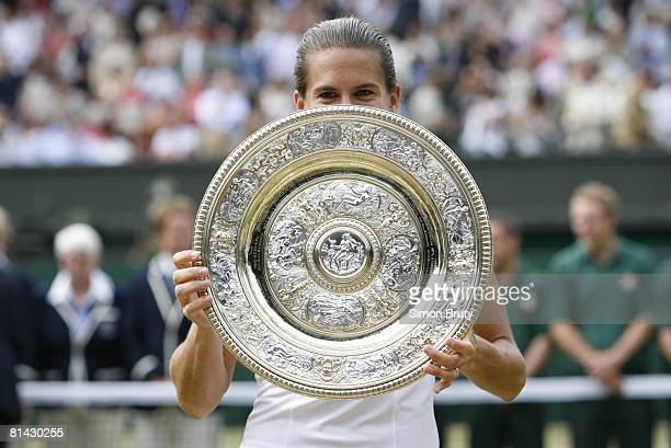 Tennis Wimbledon Closeup of France Amelie Mauresmo victorious with Rosewater Dish trophy after winning Finals vs Belgium Justine HeninHardenne at All...