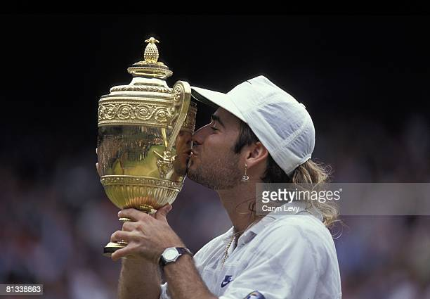 Tennis Wimbledon Closeup of USA Andre Agassi victorious with trophy after winning Finals vs Croatia Goran Ivanisevic at All England Club London...