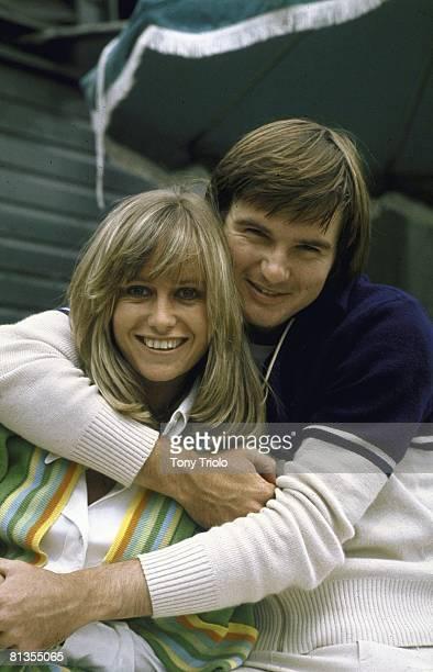 Tennis: Wimbledon, Closeup portrait of USA Jim Connors hugging celebrity actress and girlfriend Susan George at All England Club, London, England...