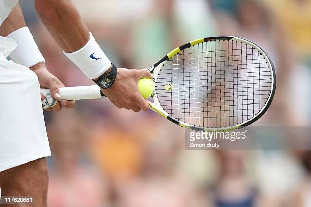 Wimbledon Closeup view Spain Rafael Nadal hands holding racquet with ball during Men's 4th Round match vs Argentina Juan Martin Del Potro at All...