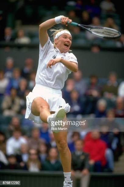 Wimbledon Czech Republic Jana Novotna in action vs Switzerland Martina Hingis during Women's Final match at All England Club London England 7/3/1997...