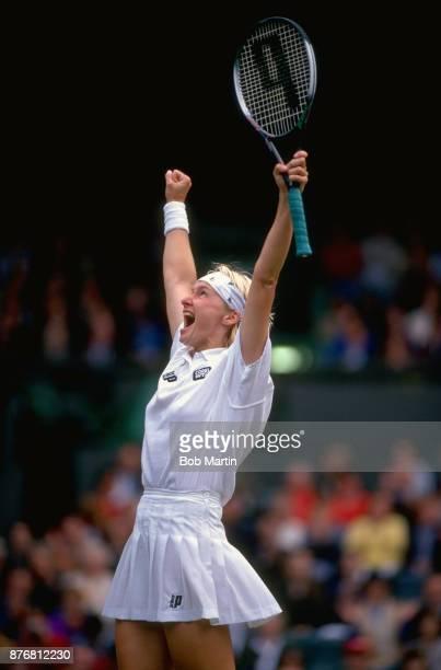 Wimbledon Czech Republic Jana Novotna victorious during Women's Final match vs Switzerland Martina Hingis at All England Club London England 7/3/1997...