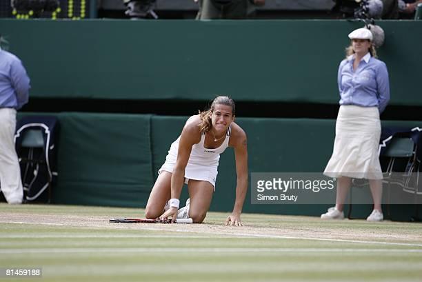 Tennis Wimbledon France Amelie Mauresmo victorious after winning Finals vs Belgium Justine HeninHardenne at All England Club London England 7/8/2006