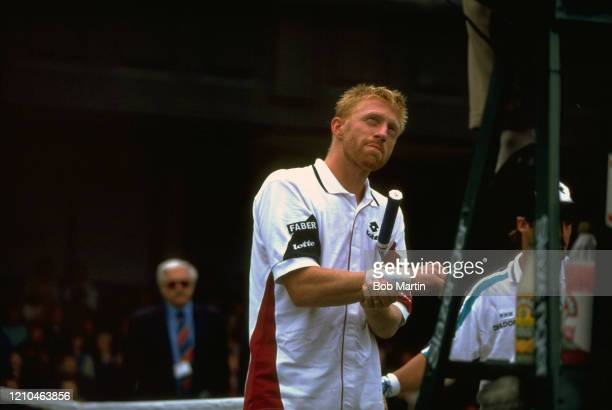 Wimbledon Germany Boris Becker grabbing his wrist in pain during match at All England Club London England 6/28/1996 CREDIT Bob Martin