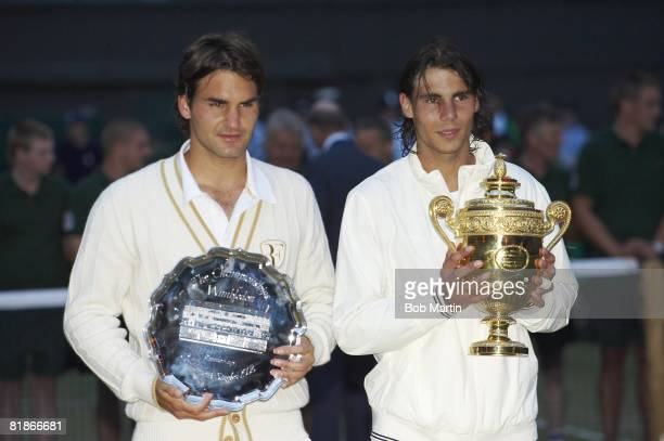 Wimbledon Spain Rafael Nadal victorious with Gentlemen's Singles Trophy and Switzerland Roger Federer with runnerup trophy after Finals match at All...