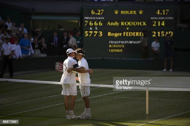 Wimbledon Switzerland Roger Federer victorious embracing USA Andy Roddick after winning Men's Finals match at All England Club London England...