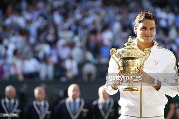Wimbledon Switzerland Roger Federer victorious with Gentlemen's Singles Trophy after winning Finals match vs USA Andy Roddick at All England Club...