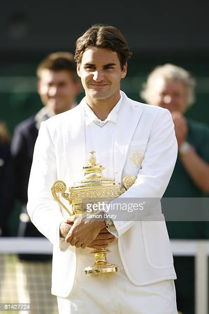 Tennis Wimbledon Switzerland Roger Federer victorious with trophy after winning Finals match vs Spain Rafael Nadal at All England Club London England...