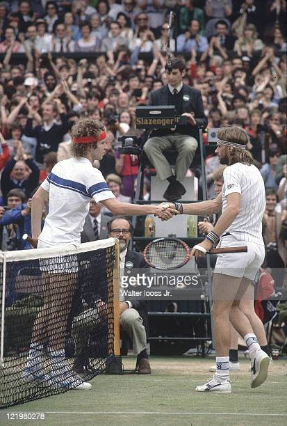 Wimbledon USA John McEnroe victorious shaking hands with Sweden Bjorn Borg at net after winning Men's Final at All England Club London England...