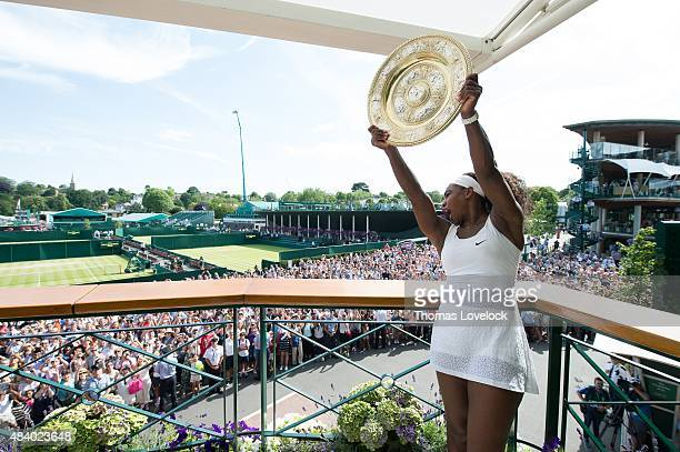 Wimbledon USA Serena Williams victorious holding up Venus Rosewater Dish in Members' Balcony after winning Women's Final at All England Club London...