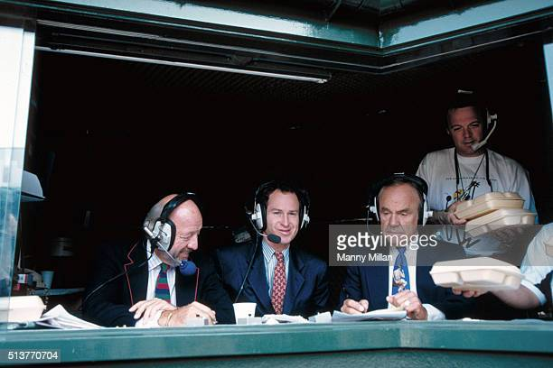 Wimbledon View of NBC announcers Bud Collins John McEnroe and Dick Enberg in booth during telecast of USA Andre Agassi vs USA Pete Sampras Men's...
