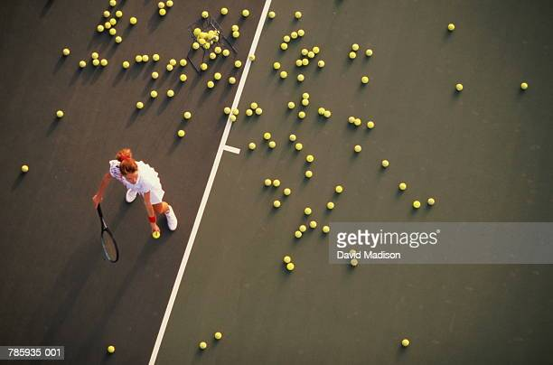 Tennis, woman practising serve, elevated view