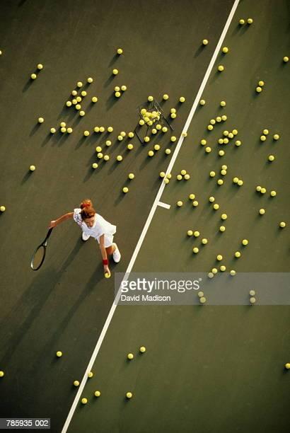 Tennis, woman practising serve, overhead view