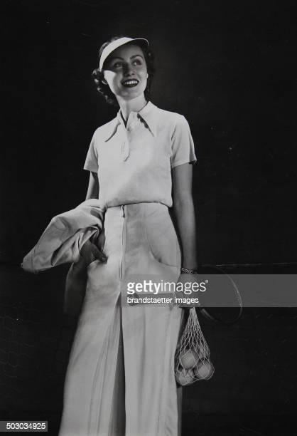 Tennis women's fashion A model wearing a shirt and a pair of flannels About 1935 Photograph by Becker Maass Berlin
